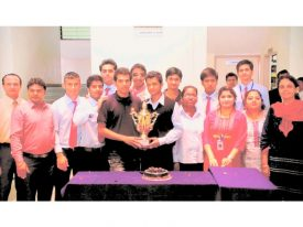 sports winners Faculty and students with the football trophy